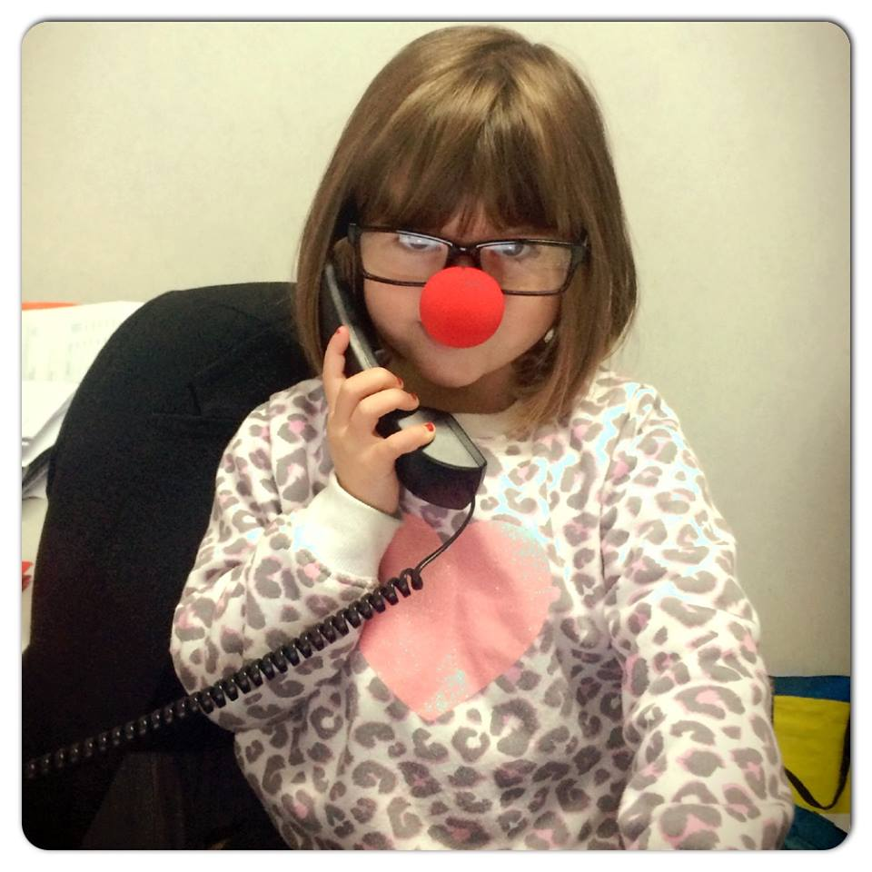 Ruby running the Harcourts Thames office with her red nose